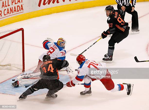 Auston Matthews of Team North America scores a first period goal past Sergei Bobrovsky of Team Russia after a pass by Connor McDavid in the first...