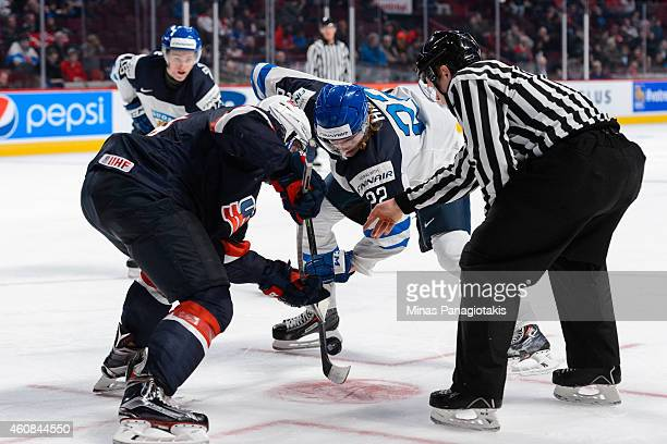 Auston Matthews of Team United States and Roope Hintz of Team Finland take a faceoff during the 2015 IIHF World Junior Hockey Championship game at...