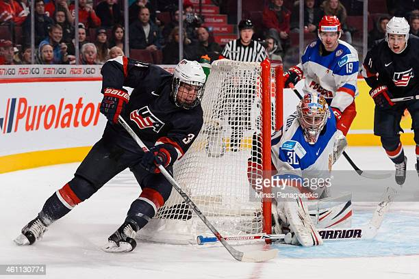 Auston Matthews of Team United States wraps around the net of Igor Shesterkin of Team Russia in a quarterfinal round during the 2015 IIHF World...