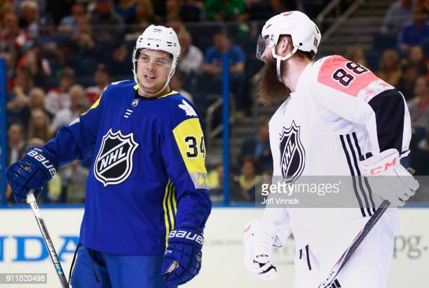 Auston Matthews of the Toronto Maple Leafs and Brent Burns of the San Jose Sharks talk during the 2018 Honda NHL All-Star Game between the Atlantic...