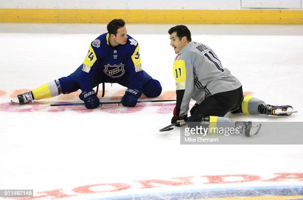Auston Matthews of the Toronto Maple Leafs and Brian Boyle of the New Jersey Devils stretch prior to the 2018 Honda NHL All-Star Game at Amalie Arena...