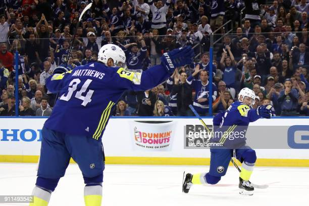 Auston Matthews of the Toronto Maple Leafs and Jack Eichel of the Buffalo Sabres celebrate after a goal in the second half during the 2018 Honda NHL...
