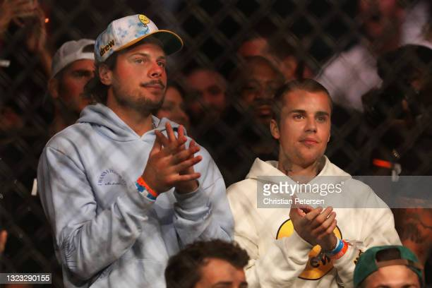 Auston Matthews of the Toronto Maple Leafs and musician Justin Bieber in attendance to UFC 263 at Gila River Arena on June 12, 2021 in Glendale,...