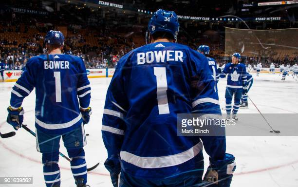 Auston Matthews of the Toronto Maple Leafs and teammates wear jersey's honouring Leafs legend Johnny Bower during warmup before facing the Tampa Bay...