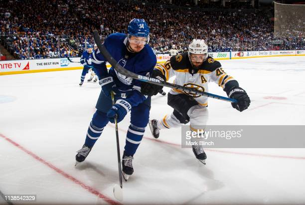 Auston Matthews of the Toronto Maple Leafs battles against David Krejci of the Boston Bruins during the second period during Game Six of the Eastern...