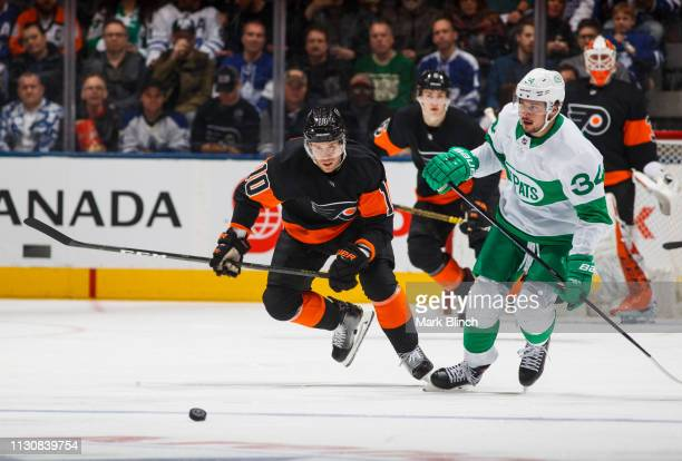 Auston Matthews of the Toronto Maple Leafs battles for the puck against Corban Knight of the Philadelphia Flyers during the second period at the...