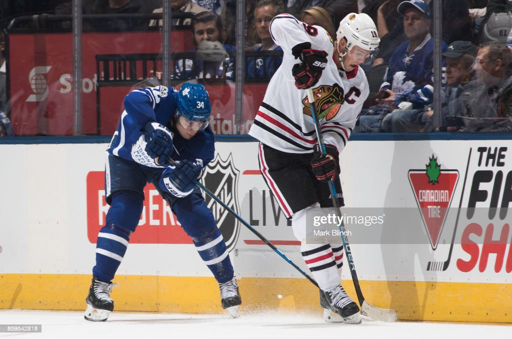 Auston Matthews #34 of the Toronto Maple Leafs battles with Jonathan Toews #19 of the Chicago Blackhawks during the second period October 9, 2017 at the Air Canada Centre in Toronto, Ontario, Canada.