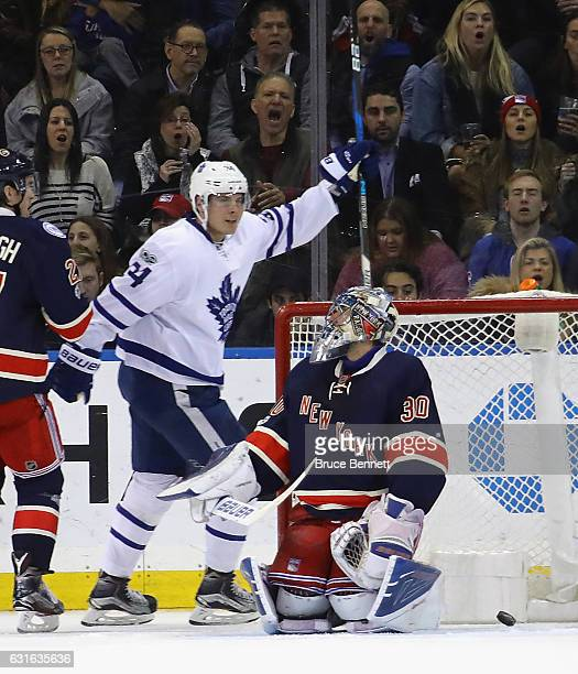 Auston Matthews of the Toronto Maple Leafs celebrates a second period goal by Connor Brown against Henrik Lundqvist of the New York Rangers at...