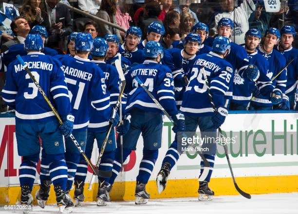 Auston Matthews of the Toronto Maple Leafs celebrates his goal with teammates James van Riemsdyk William Nylander Jake Gardiner and Alexey Marchenko...