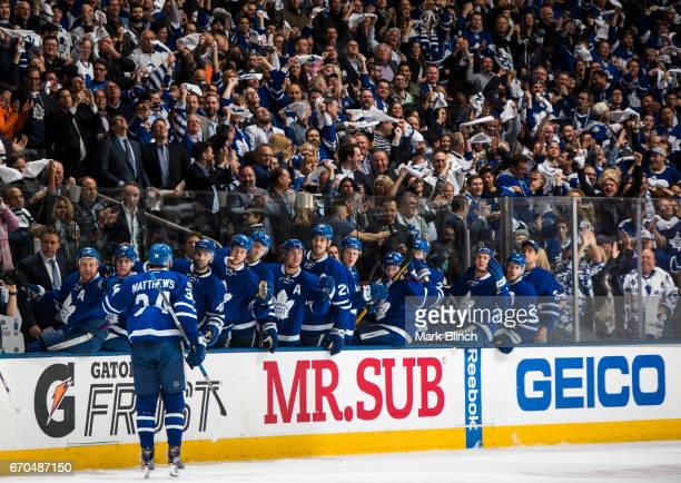 Auston Matthews of the Toronto Maple Leafs celebrates his goal with teammates against the Washington Capitals during the first period in Game Three...