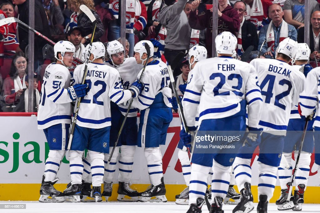 Auston Matthews #34 of the Toronto Maple Leafs celebrates his overtime goal with teammates against the Montreal Canadiens during the NHL game at the Bell Centre on October 14, 2017 in Montreal, Quebec, Canada. The Toronto Maple Leafs defeated the Montreal Canadiens 4-3 in overtime.