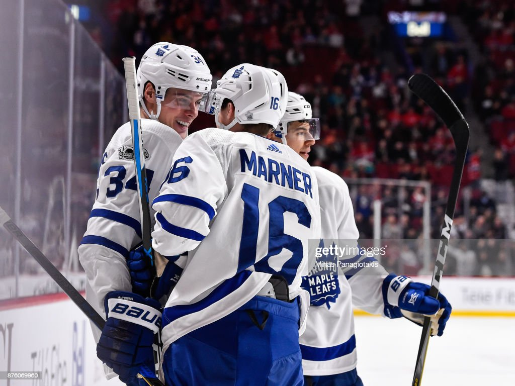 Auston Matthews #34 of the Toronto Maple Leafs celebrates his third period goal with teammate Mitchell Marner #16 against the Montreal Canadiens during the NHL game at the Bell Centre on November 18, 2017 in Montreal, Quebec, Canada. The Toronto Maple Leafs defeated the Montreal Canadiens 6-0.