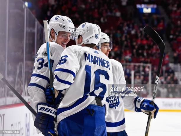Auston Matthews of the Toronto Maple Leafs celebrates his third period goal with teammate Mitchell Marner against the Montreal Canadiens during the...