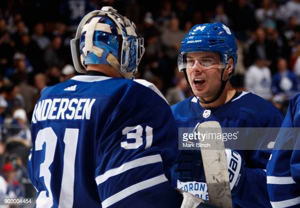 Auston Matthews of the Toronto Maple Leafs celebrates with teammate Frederik Andersen after the Leafs defeated the Vancouver Canucks at the Air...