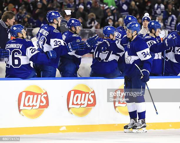 Auston Matthews of the Toronto Maple Leafs celebrates with the bench after scoring a third period goal on the Detroit Red Wings during the 2017...
