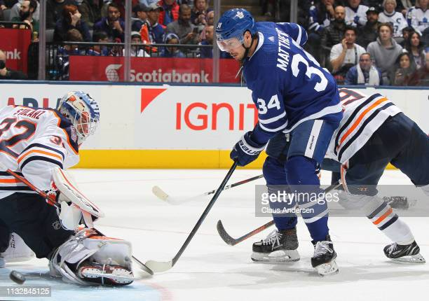 Auston Matthews of the Toronto Maple Leafs directs a shot wide past Anthony Stolarz of the Edmonton Oilers during an NHL game at Scotiabank Arena on...