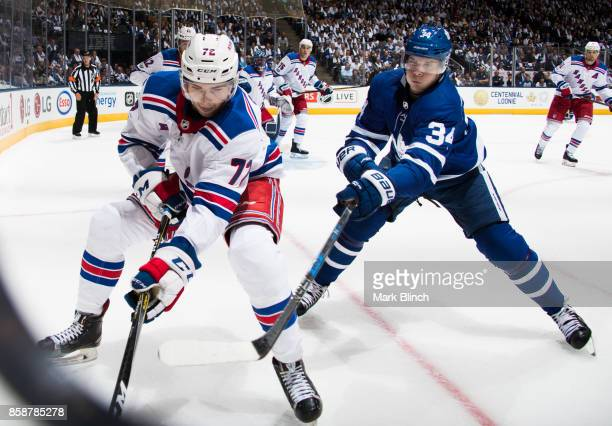 Auston Matthews of the Toronto Maple Leafs follows Filip Chytil of the New York Rangers into the corner during the first period October 7 2017 at the...
