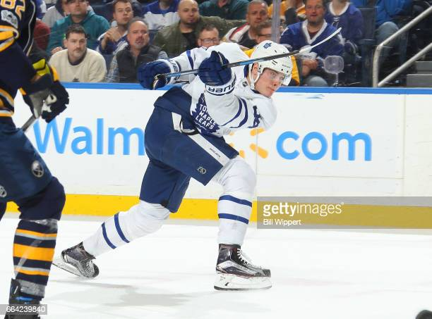 Auston Matthews of the Toronto Maple Leafs follows through on a shot against the Buffalo Sabres during an NHL game at the KeyBank Center on April 3...