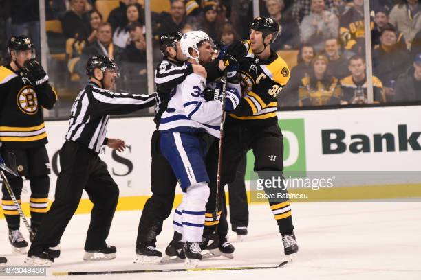 Auston Matthews of the Toronto Maple Leafs gets physical with Zdeno Chara of the Boston Bruins at the TD Garden on November 11, 2017 in Boston,...