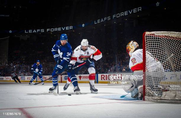 Auston Matthews of the Toronto Maple Leafs goes to the net against Aaron Ekblad of the Florida Panthers and Roberto Luongo during the third period at...