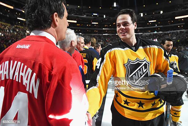 Auston Matthews of the Toronto Maple Leafs greets former NHL player Brendan Shanahan prior to the 2017 Honda NHL AllStar Game at Staples Center on...