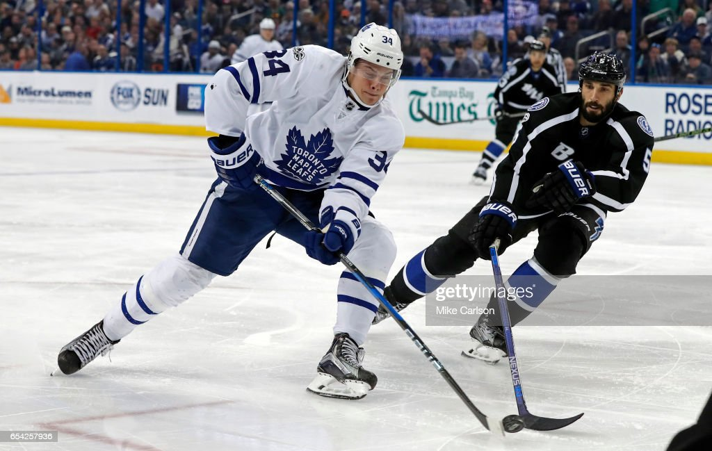 Auston Matthews #34 of the Toronto Maple Leafs has a shot challenged by Jason Garrison #5 of the Tampa Bay Lightning during the third period at the Amalie Arena on March 16, 2017 in Tampa, Florida.