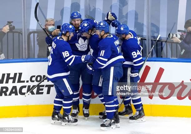 Auston Matthews of the Toronto Maple Leafs is congratulated by his teammates after scoring a goal against the Columbus Blue Jackets during the second...