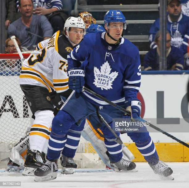 Auston Matthews of the Toronto Maple Leafs looks for a puck to tip in front of Charlie McAvoy of the Boston Bruins in Game Three of the Eastern...