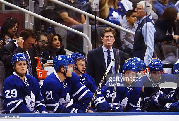 Auston Matthews of the Toronto Maple Leafs looks on with head coach Mike Babcock as their team plays the Montreal Canadiens during the first period...