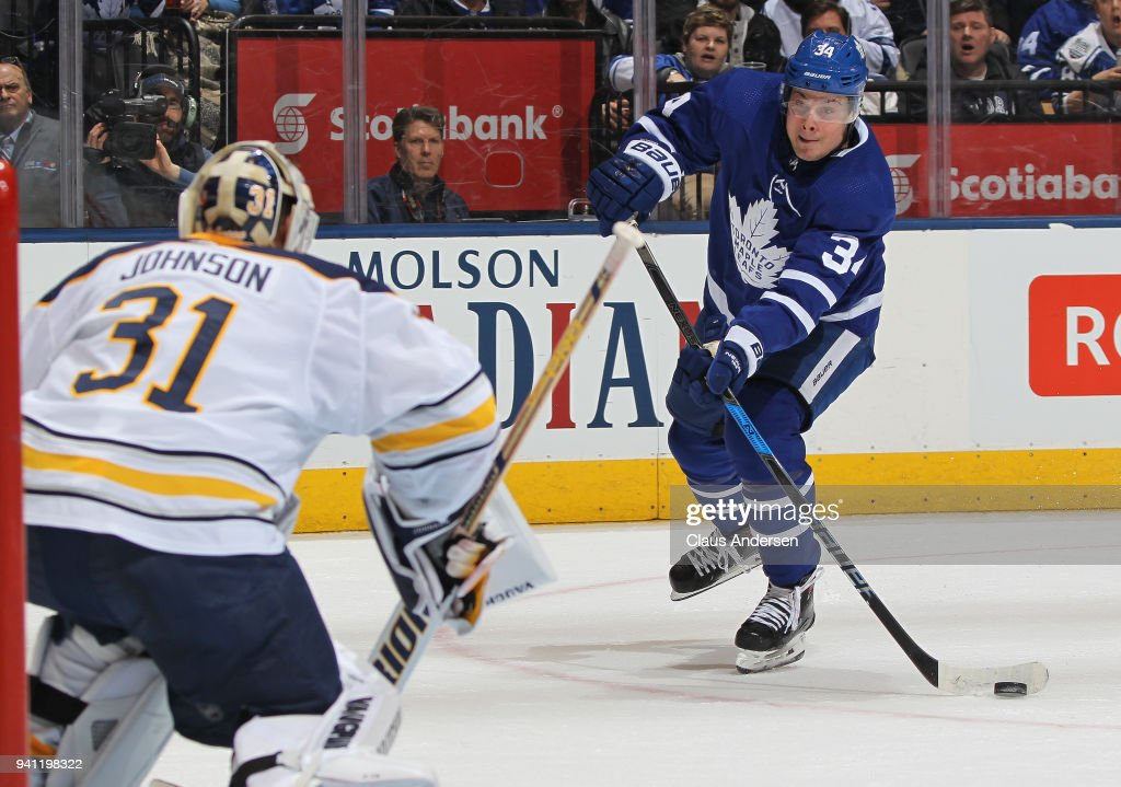 Auston Matthews #34 of the Toronto Maple Leafs looks to take a shot at Chad Johnson #31 of the Buffalo Sabres during an NHL game at the Air Canada Centre on April 2, 2018 in Toronto, Ontario, Canada. The Maple Leafs defeated the Sabres 5-2.
