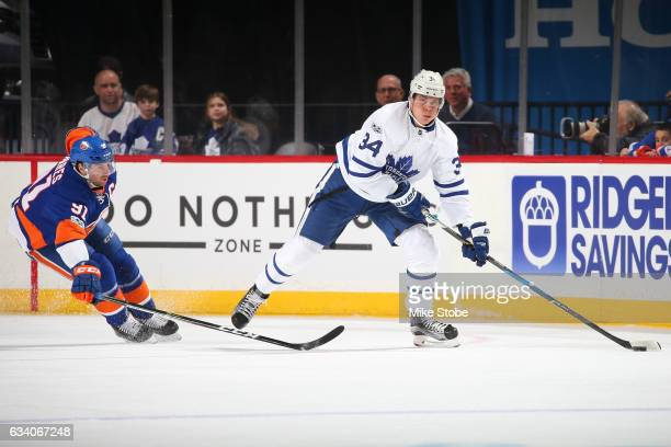 Auston Matthews of the Toronto Maple Leafs plays the puck against John Tavares of the New York Islanders at the Barclays Center on February 6 2017 in...