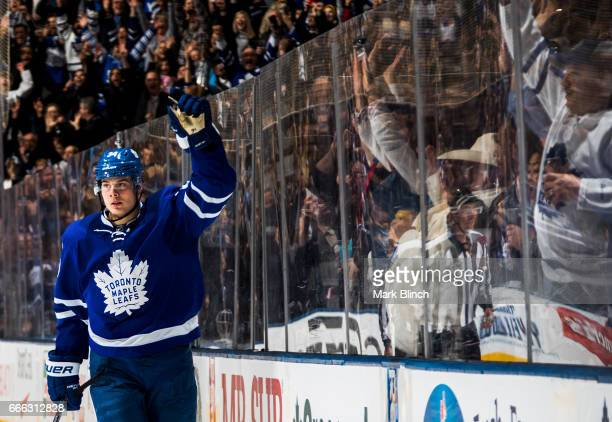 Auston Matthews of the Toronto Maple Leafs reacts after scoring his 40th goal of the season while playing against the Pittsburgh Penguins during the...