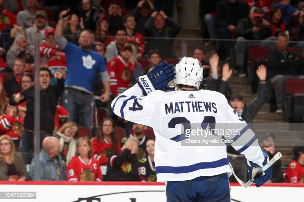 Auston Matthews of the Toronto Maple Leafs reacts to the crowd after the Leafs scored against the Chicago Blackhawks at the United Center on October...