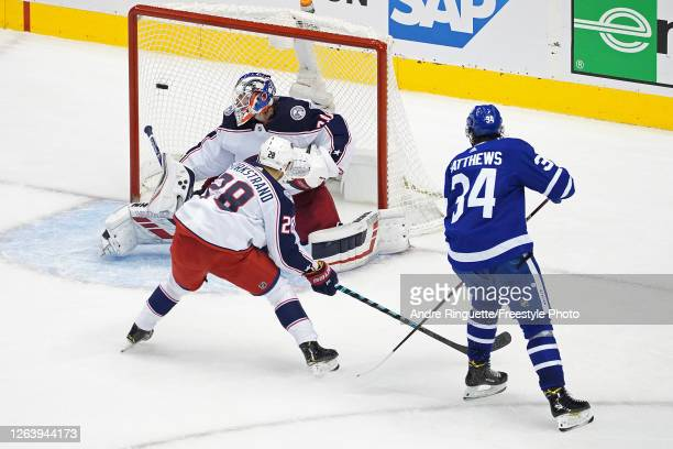 Auston Matthews of the Toronto Maple Leafs scores a goal past Joonas Korpisalo of the Columbus Blue Jackets during the second period in Game Two of...