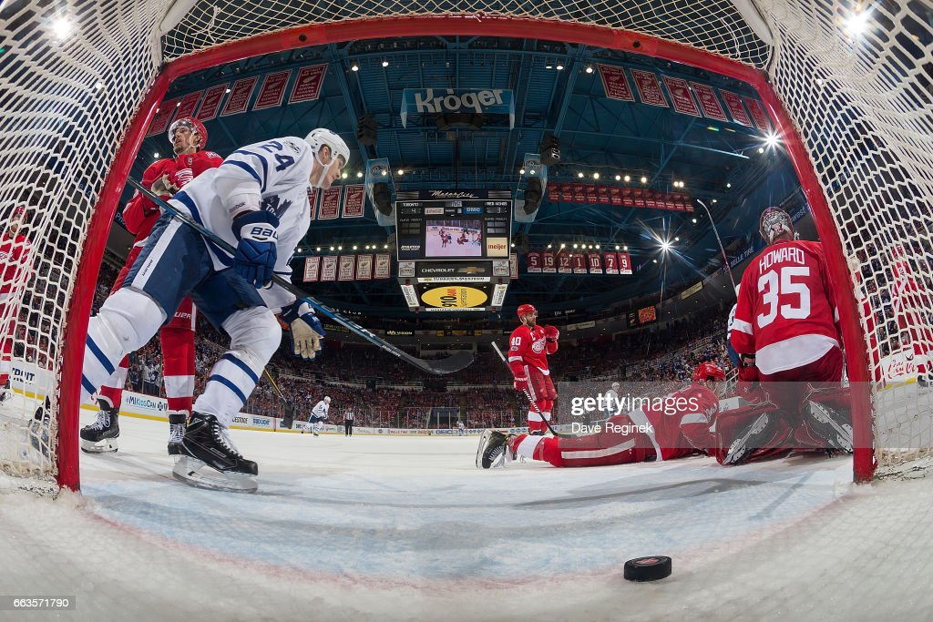 Auston Matthews #34 (not pictured) of the Toronto Maple Leafs scores a third period goal on Jimmy Howard #35 of the Detroit Red Wings as Brian Boyle #24 of the Leafs goes to celebrate during an NHL game at Joe Louis Arena on April 1, 2017 in Detroit, Michigan. The Leafs defeated the Wings 5-4.