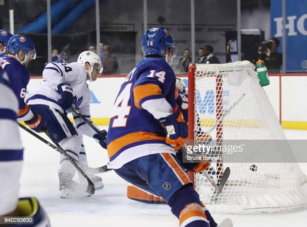 Auston Matthews of the Toronto Maple Leafs scores at 1602 of the third period against Christopher Gibson of the New York Islanders at the Barclays...
