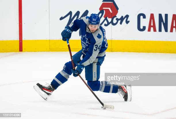 Auston Matthews of the Toronto Maple Leafs shoots the puck against the Vancouver Canucks during the third period at the Scotiabank Arena on February...