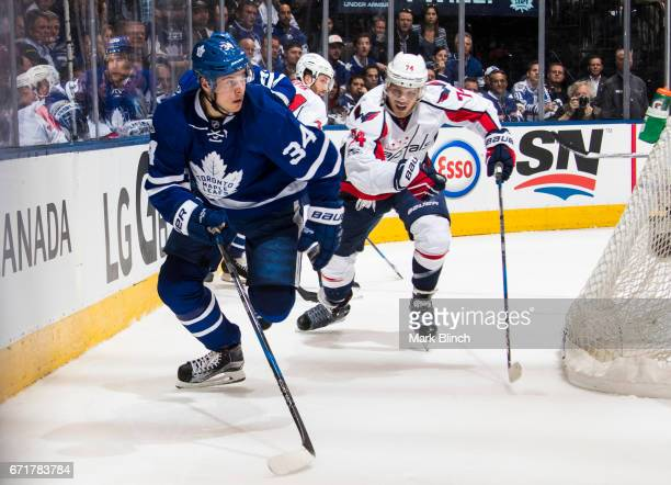 Auston Matthews of the Toronto Maple Leafs skates against John Carlson of the Washington Capitals during the first period in Game Four of the Eastern...