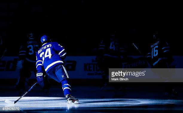 Auston Matthews of the Toronto Maple Leafs skates in the pregame spotlight before his team plays the Montreal Canadiens in their NHL preseason game...
