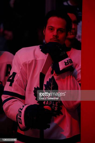 Auston Matthews of the Toronto Maple Leafs stands on the bench for the national anthems prior to the start of the game against the Florida Panthers...