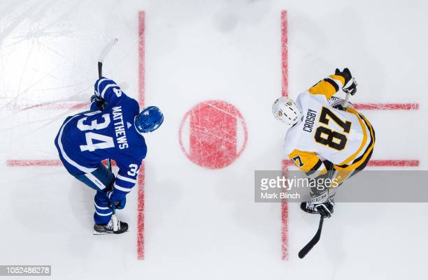 Auston Matthews of the Toronto Maple Leafs takes a faceoff against Sidney Crosby of the Pittsburgh Penguins during the first period at the Scotiabank...
