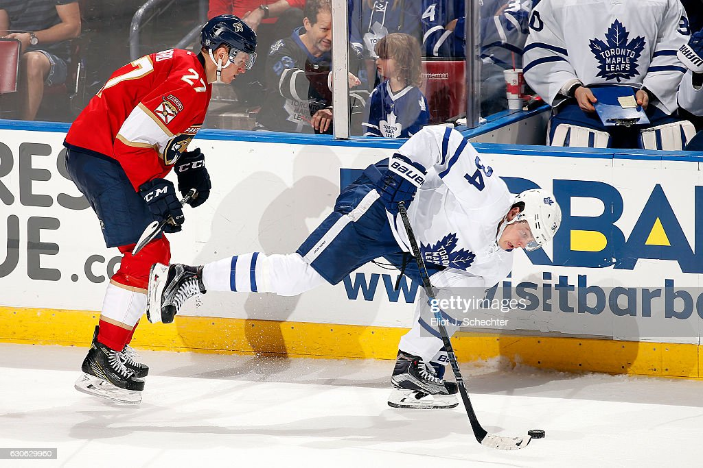 Auston Matthews #34 of the Toronto Maple Leafs tangles with Nick Bjugstad #27 of the Florida Panthers at the BB&T Center on December 28, 2016 in Sunrise, Florida.