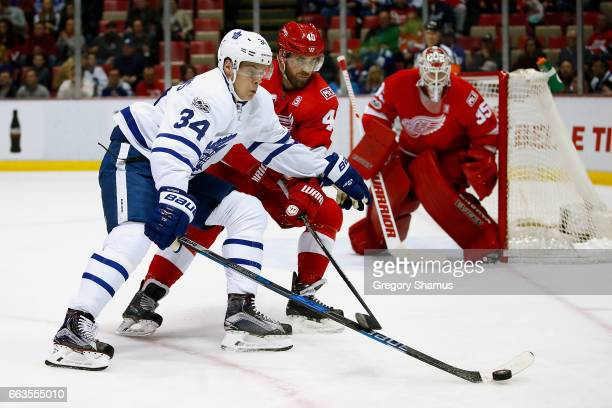 Auston Matthews of the Toronto Maple Leafs tries to get a shot off around Henrik Zetterberg of the Detroit Red Wings during the first period at Joe...
