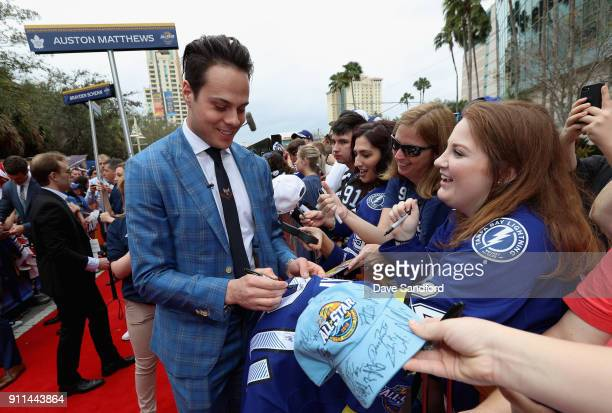 Auston Matthews of the Toronto Maple Leafs walks the red carpet prior to playing in the 2018 Honda NHL AllStar Game at Amalie Arena on January 28...