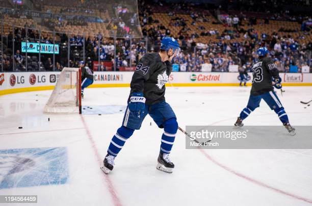 Auston Matthews of the Toronto Maple Leafs wear jerseys honouring the Canadian Armed Forces during warmup before facing the Chicago Blackhawks at the...