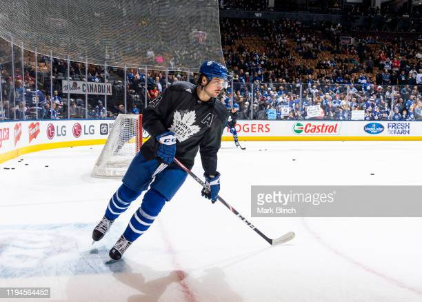 Auston Matthews of the Toronto Maple Leafs wears a jersey honouring the Canadian Armed Forces during warmup before facing the Chicago Blackhawks at...
