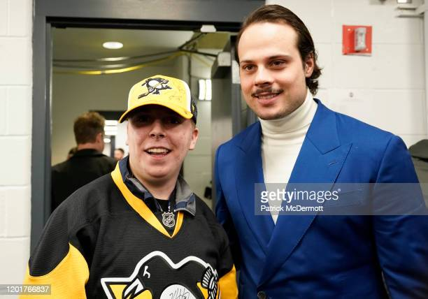 Auston Matthews of the Toronto Maple Leafs welcomes MakeAWish kid Spencer in the locker room for a visit prior to the 2020 NHL AllStar Skills...