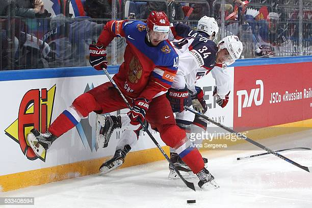 Auston Matthews of USA checks Sergei Kalinin of Russia during the 2016 IIHF World Championship bronze medal game at the Ice Palace on May 22 2016 in...