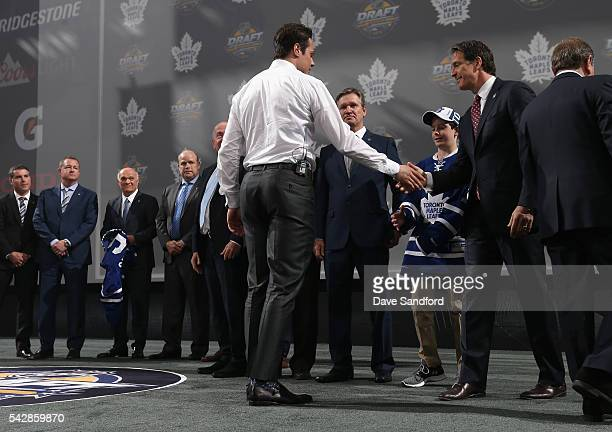 Auston Matthews shakes the hand of president Brendan Shanahan of the Toronto Maple Leafs after being selected first overall by the Toronto Maple...