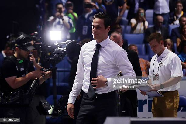Auston Matthews walks to the stage after being selected first overall by the Toronto Maple Leafs during round one of the 2016 NHL Draft on June 24...